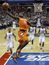 Syracuse's Dion Waiters (3) goes up for a dunk in the second half of an NCAA college basketball game against the Villanova, Wednesday, Jan. 11, 2012, in Philadelphia. Syracuse won 79-66. (AP Photo/Matt Slocum)