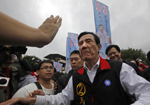 Taiwan's President and presidential candidate Ma Ying-jeou is greeted by supporters during an election rally Thursday, Jan. 12, 2012 in New Taipei City, Taiwan. Taiwan will hold its presidential election on Saturday Jan. 14. (AP Photo/Vincent Yu)