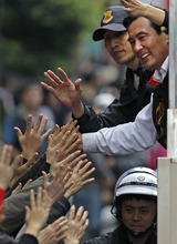 Taiwan's President and Nationalist Party's presidential candidate Ma Ying-jeou, right, is greeted by supporters during an election rally Thursday, Jan. 12, 2012 in New Taipei City, Taiwan. Taiwan will hold its presidential election on Jan. 14, 2012. (AP Photo/Vincent Yu)
