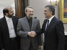 In this photo released by the Turkish Presidency Press Office, Turkish President Abdullah Gul, right, welcomes Iran's Parliamentary Speaker Ali Larijani, center, before a meeting in Ankara, Turkey, Thursday, Jan. 12, 2012.  Turkey, a U.S. ally that relies on Iranian oil and gas imports, signalled Thursday that it will not comply with American sanctions against Iran regarding its nuclear program. Turkey indicated that it will only enforce sanctions that have been approved by the United Nations, and its announcement is a setback to U.S. sanctions aimed at halting what Western governments say is Iran's effort to develop nuclear weapons. (AP Photo / Irfan Yildiz, Turkish Presidency Press Office, HO)