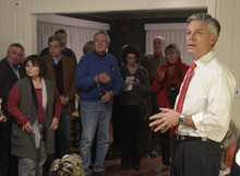 Republican presidential candidate, former Utah Gov. Jon Huntsman listens to a question from a voter at a house party held by Karen & Woody Eitel for Huntsman in Randolph, N.H., Friday evening, Jan. 6, 2012. (AP Photo/Stephan Savoia)