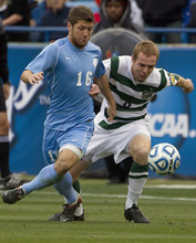 North Carolina midfielder Enzo Martinez (16) battles for the ball with UNC Charlotte midfielder Aidan Kirkbride (8) in the first half of their NCAA College Cup soccer championship game at Regions Park in Hoover, Ala., Sunday, Dec.11, 2011.  (AP Photo/Dave Martin)