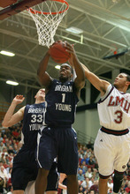BYU's Charles Abouo (1) is fouled by Loyola Marymount's Anthony Ireland (3) in the first half during an NCAA college basketball game at Gersten Pavilion, Thursday, Jan. 5, 2012, in Los Angeles, Calif. (AP Photo/Ringo H.W. Chiu)