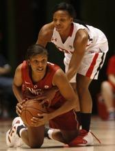 Chris Detrick  |  The Salt Lake Tribune Stanford's Amber Orrange (33) and Utah's Janita Badon (1) go for the ball during the game at the Huntsman Center Thursday January 12, 2012. Stanford won the game 62-43.
