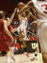 Chris Detrick  |  The Salt Lake Tribune Utah's Janita Badon (1) passes the ball around Stanford's Lindy La Rocque (15) during the game at the Huntsman Center Thursday January 12, 2012.