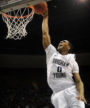 James Roh | Daily Herald BYU's Brandon Davies (0) slam dunks the ball during the second half against San Francisco at the Marriott Center in Provo on Saturday, Jan. 7, 2012.