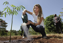 Supermodel and United Nations Environment Programme (UNEP) Goodwill Ambassador Gisele Bundchen pours water on a newly planted tree during a tree-planting ceremony at the UNEP headquarters in Nairobi, Kenya Friday, Jan. 13, 2012. Bundchen attended a tree-planting ceremony and gave a press conference in the context of the