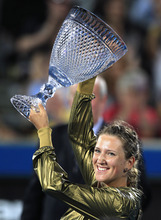Victoria Azarenka of Belarus holds up her winner's trophy at the end of the women's final match against China's Li Na at the Sydney International tennis tournament in Sydney, Friday, Jan. 13, 2012. Azeranka won the match 6-2, 1-6, 6-3. (AP Photo/Rick Rycroft)