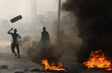 Angry youths burn debris following the removal of a fuel subsidy by the government in Lagos, Nigeria, Tuesday, Jan. 10, 2012. Angry youths erected a burning roadblock outside luxury enclaves in Nigeria's commercial capital Tuesday as a paralyzing national strike over fuel prices and government corruption entered its second day. (AP Photo/Sunday Alamba)