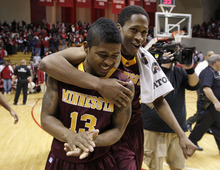 Minnesota's Maverick Ahanmisi and Rodney Williams, right, react after Minnesota defeated Indiana 77-74 in an NCAA college basketball game Thursday, Jan. 12, 2012, in Bloomington, Ind. (AP Photo/Darron Cummings)