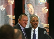 Steve Griffin  |  The Salt Lake Tribune    Utah Attorney General Mark Shurtleff, left, stands with U.S. Attorney General Eric Holder after introducing him as the keynote speaker during the Matin Luther King Human Rights Foundation luncheon at the Sheraton Hotel in Salt Lake City, Utah  Friday, January 13, 2012.