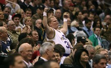 Steve Griffin  |  The Salt Lake Tribune  A Jazz fan shows his muscles during second half action of the Jazz versus Lakers game at EnergySlutions Arena in Salt Lake City, Utah  Wednesday, January 11, 2012.