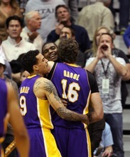 Steve Griffin  |  The Salt Lake Tribune  Andrew Bynum, of the Lakers, is mobbed by teammates Pau Gasol and Matt Barnes after Bynum blocked Al Jefferson's last second shot during second half action of the Jazz versus Lakers game at EnergySlutions Arena in Salt Lake City, Utah  Wednesday, January 11, 2012.