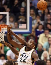 Steve Griffin  |  The Salt Lake Tribune  Utah's Paul Millsap goes for a rebound during second half action of the Jazz versus Lakers game at EnergySlutions Arena in Salt Lake City, Utah  Wednesday, January 11, 2012.