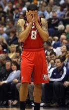 Kim Raff  | The Salt Lake Tribune New Jersey Nets player Deron Williams wipes sweat off his face during Jazz free throws during the first half against the Utah Jazz at EnergySolutions Arena in Salt Lake City on Saturday.