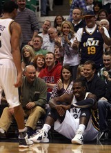 Kim Raff |The Salt Lake Tribune Utah Jazz player Paul Millsap sits in the crowd at the end of the first half reacting to the big lead over the New Jersey Nets at EnergySolutions Arena in Salt Lake City on Saturday.