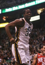 Kim Raff  | The Salt Lake Tribune C.J. Mills of the Jazz reacts to dunking the ball after a turnover by the New Jersey Nets during the first half of game at EnergySolutions Arena in Salt Lake City on Saturday.