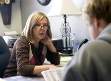 Al Hartmann  |  The Salt Lake Tribune Lone Peak High School counselor Valerie Ross checks a student's class schedule to make sure they are on track to fulfill graduation requirements  She also informs students of scholarships and college opportunites.