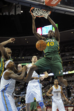 Utah Jazz forward Jeremy Evans (40) dunks against the Denver Nuggets during the third quarter of an NBA basketball game, Sunday, Jan. 15, 2012, in Denver. (AP Photo/Jack Dempsey)