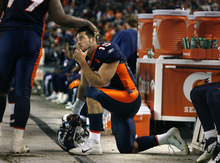 Scott Sommerdorf  |  The Salt Lake Tribune              Broncos QB Tim Tebow gets some consolation from Denver DT Marcus Thomas in the closing minutes of the loss to the Patriots. The New England Patriots beat the Denver Broncos 41-23, Sunday, December 18, 2011.