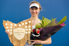 Mona Barthel of Germany holds the trophy after beating Yanina Wickmayer of Belgium 6-1, 6-2 in their final match to win the Hobart International tennis tournament in Hobart, Australia, Saturday, Jan. 14, 2012. (AP Photo/Richard Jupe)