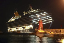 The luxury cruise ship Costa Concordia leans after it ran aground off the coast of Isola del Giglio island, Italy, gashing open the hull and forcing some 4,200 people aboard to evacuate aboard lifeboats to the nearby Isola del Giglio island, early Saturday, Jan. 14, 2012. About 1,000 Italian passengers were onboard, as well as more than 500 Germans, about 160 French and about 1,000 crew members. (AP Photo/Giorgio Fanciulli, Giglionews.it)