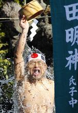 A half-naked shrine parishioner using a wooden tub pours cold water onto himself during an annual cold-endurance festival at the Kanda Myojin Shinto shrine in Tokyo Saturday, Jan. 14, 2012. (AP Photo/Koji Sasahara)