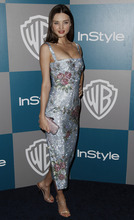 Miranda Kerr arrives at the 2012 Warner Bros. and InStyle Golden Globe After Party at the Beverly Hilton in Los Angeles. on Sunday, Jan. 15, 2012. (AP Photo/Matt Sayles)