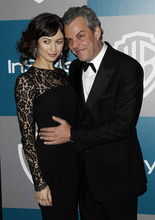 Danny Huston, left, and Olga Kurylenko arrive at the 2012 Warner Bros. and InStyle Golden Globe After Party at the Beverly Hilton in Los Angeles. on Sunday, Jan. 15, 2012. (AP Photo/Matt Sayles)