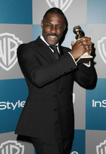 Idris Elba arrives at the 2012 Warner Bros. and InStyle Golden Globe After Party at the Beverly Hilton in Los Angeles. on Sunday, Jan. 15, 2012. (AP Photo/Matt Sayles)