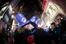 Kelsey Harpin, 21, left, and Joe Courcy, 22, both from Boston, share a midnight kiss during the new year's   celebration at Times Square, Sunday, Jan. 1, 2011, in New York. (AP Photo/Julio Cortez)