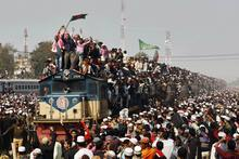 Hundreds of Bangladeshi Muslim try to return home after attending the three-day Islamic Congregation in Tongi station, outskirts of Bangladesh, Dhaka, Sunday, Jan. 15, 2012. The congregation held each year since 1966, is among the world's largest religious gatherings. (AP Photo/Pavel Rahman)