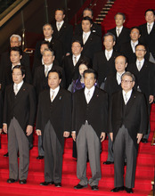 Japanese Prime Minister Yoshihiko Noda, front row second left, and his new Cabinet members stand together for an official group photo session at the prime minister's official residence in Tokyo Friday, Jan. 13, 2012. Front row from left are: Agriculture, Forestry and Fisheries Minister Michihiko Kano, Noda, Deputy Prime Minister in charge of social security and tax reform Katsuya Okada and Financial and Postal Services Minister Shozaburo Jimi. (AP Photo/Shizuo Kambayashi)
