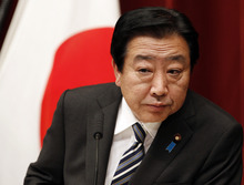 Japanese Prime Minister Yoshihiko Noda listens to a reporter's question during a press conference in Tokyo Friday, Jan. 13, 2012. Noda replaced five members of his Cabinet on Friday in a bid to win more cooperation from the opposition to raise the sales tax and rein in the country's bulging fiscal deficit. (AP Photo/Koji Sasahara)