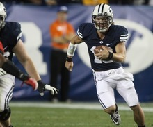 Rick Egan  | The Salt Lake Tribune   BYU QB, Riley Nelson runs the ball for the Cougars, late in the fourth quarter, as BYU lost to Utah 54-10, Saturday, September 17, 2011.