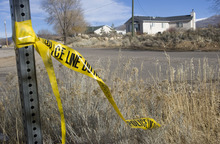 Al Hartmann  |  The Salt Lake Tribune Crime scene tape remains near 399 South and 600 East in Mount Pleasant on Tuesday. The house at right is the residence of Leroy and Dorotha Fullwood, who were killed on Dec. 30.