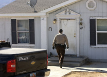 Al Hartmann  |  The Salt Lake Tribune Mount Pleasant police and San Pete County Sheriff deputies search a home in Moroni along Highway 132 on Tuesday where Logan MacFarland lived. He is a suspect in the Dec. 30 killings of Leroy and Dorotha Fullwood.