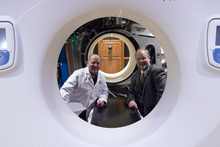 Rick Egan  | The Salt Lake Tribune  John Hayes, left, with Thomas Rockwell Mackie inside the TomoTherapy machine Mackie invented during an open house at St. Mark's Hospital to showcase new image-guided radiation therapy technology.
