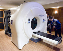 Rick Egan  | The Salt Lake Tribune  Guests check out the Gamma West Cancer Services' TomoTherapy machine during an open house Friday at St. Mark's Hospital to showcase new image-guided radiation therapy technology.