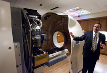 Rick Egan  | The Salt Lake Tribune  Dave Vincent talks about the Gamma West Cancer Services' TomoTherapy machine during an open house at St. Mark's Hospital to showcase new image-guided radiation therapy technology Friday.