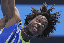 Gael Monfils of France  serves to Marinko Matosevic of Australia during their first round match at the Australian Open tennis championship, in Melbourne, Australia, Tuesday, Jan. 17, 2012. (AP Photo/Andrew Brownbill)