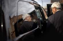 Republican presidential candidate, former House Speaker Newt Gingrich is reflected in a car window as leaves the Art Trail Gallery during a campaign stop, Tuesday, Jan. 17, 2012, in Florence, S.C. (AP Photo/David Goldman)