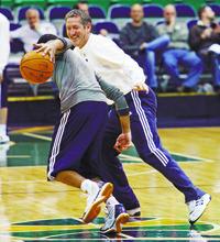 Steve Griffin  |  The Salt Lake Tribune  Utah assistant coach Jeff Hornacek  guards Devin Harris during shoot around before the Lakers game at EnergySlutions Arena in Salt Lake City, Utah  Wednesday, January 11, 2012.