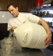Rick Egan  | The Salt Lake Tribune  Chef Gavin Baker pours liquid nitrogen into a bowl in his test kitchen. The Mist Project, his