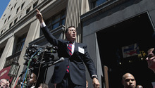 Comedian Stephen Colbert speaks to supporters on the sidewalk in front of the Federal Election Commission in Washington, Thursday, June 30, 2011. (AP Photo/Cliff Owen)