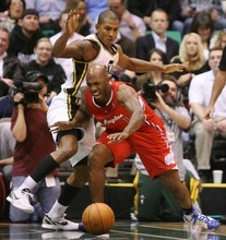 Steve Griffin  |  The Salt Lake Tribune   Utah's Raja Bell knocks the ball away from Clippers guard Chauncey BIllups to pass during first half action of the Utah Jazz versus Los Angeles Clippers game at EnergySolutions Arean in Salt Lake City, Utah  Tuesday, January 17, 2012.