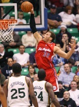 Steve Griffin  |  The Salt Lake Tribune   Blake Griffin, of the Clippers, soars to the basket as he slams the ball over Utah's Al Jeffereson and Paul Millsap during first half action of the Utah Jazz versus Los Angeles Clippers game at EnergySolutions Arean in Salt Lake City, Utah  Tuesday, January 17, 2012.