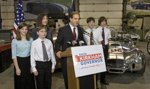 Paul Fraughton | The Salt Lake Tribune David Kirkham -- surrounded by his wife, Alisa, and their four children, Emily, 12, Josh, 11, and twin sons Chris and Nick, 15, at his motor sports business in Provo -- announces his run for governor on Wednesday, Jan. 18, 2012.