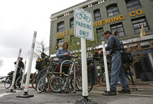 Francisco Kjolseth  |  The Salt Lake Tribune Cyclist and the press show up for Salt Lake City Mayor Ralph Becker's unveiling of the city's first bike corral in front of Squatters Pub Brewery on Thursday.