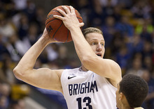 11-12mBKB vs Santa Clara Brock Zylstra 05   Brock Zylstra looks for an open teamate at the BYU Men's basketball team against Santa Clara in the Marriott Center. They defeated the Broncos 95-78.  Photo by Jonathan Hardy/BYU  January 14, 2012  © BYU Photo 2011 All Rights Reserved photo@byu.edu (801) 422-7322